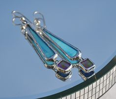 🔵 Stained Glass Blue and iridescent purple dangle earrings. Fused Glass Jewelry, Glass Earrings, Glass Pendants, Dangle Earrings, Purple Earrings, Stained Glass Crafts, Stained Glass Designs, Stained Glass Patterns, Leaded Glass