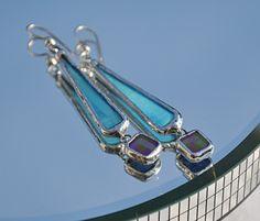 Blue and iridescent purple dangle earrings.