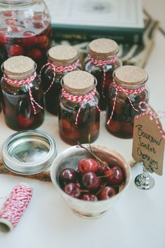 Bourbon Soaked Cherries - would be even better soaked in dark chocolate and left to harden o a cookie sheet. Mmmm dessert.