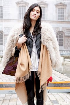 faux fur and fabulous. #MingXi all layered up  #offduty in Paris.
