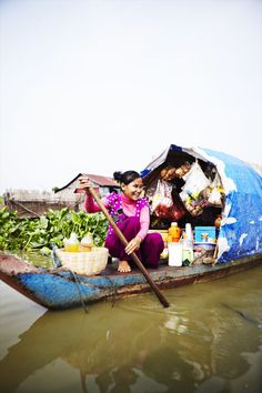A villager steers her floating coffee shop cum convenience store on the Tonlé Sap, Vietnam. Image by Mark Read / Lonely Planet Traveller. http://www.lonelyplanet.com/cambodia/travel-tips-and-articles/77779