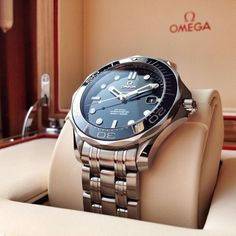 The Omega Seamaster Diver Powered by the Co-Axial calibre 2500 self-winding chronometer steel case blue dial and rotating bezel. Omega Watches Seamaster, Omega Seamaster Diver 300m, Seamaster Watch, Omega Seamaster Automatic, Omega Speedmaster, Omega Planet Ocean, Omega Seamaster Planet Ocean, Men's Watches, Cool Watches