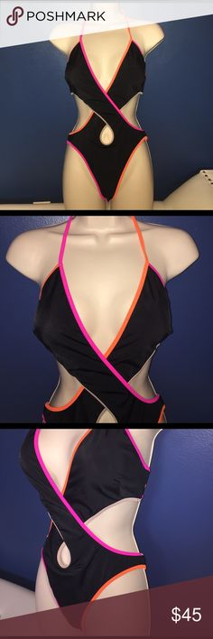 NWOT - Women's Victoria's Secret, Black Monokini NWOT- Women's, Victoria's Secret, black monokini bathing suit. One piece bathing suit with cutouts. Crosses in the front. Solid black, trimmed in tan, orange, & pink. Clasps around the back, ties around the neck. Size Medium Victoria's Secret Swim One Pieces