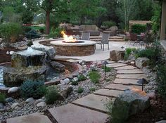 Low maintenance backyard perfect for desert homes. The gravel, rocks, and blocks of cement walk way add texture to the backyard