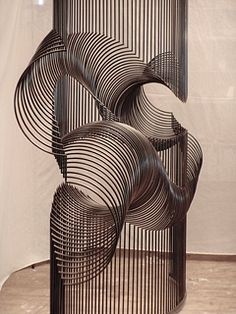 "McConnell Studios, ""Momentum."" This piece is kinetic. Each piece individually sways, acting like a millipede in motion. With the added impact of the sound of metal, it is fully interactive."