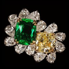 Double Happiness! Cushion shape Fancy Intense Yellow diamond and Columbia Emerald Twin Ring surrounded by pear shape white diamonds totaling 11.01 carats by dehres