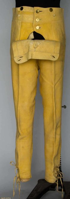"BRITISH CONSUL'S LEATHER BREECHES, BOSTON, 1790     Lot: 191     November 13, 2013 - NYC     Tan buckskin, fall front, brass & self covered buttons, breeches have leather ties at waist & at leg hems, W 30"", Inseam 27"", (stains) very good. Provenance Thomas McDonogh, appointed first British Consul to New England in 1790."