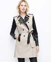 "Edgy Trench - This standout topper knows how to work the look, with luxe faux leather accents in always sophisticated black and tan. Stand collar with hook-and-eye closure and latch. Long sleeves. Front and back shoulder yoke. Shoulder epaulettes with button tabs. Double breasted button front. Self tie belt. Front vertical welt pockets. Inverted back pleat with button tab. Leather sleeves, epaulettes, pockets, undercollar and underbelt. 36"" long."