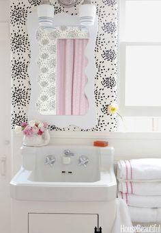 """The single bathroom so tiny, only the little sink + a shower,"" designer Krista Ewart,  1,200 sq ft beach house, Balboa Island, California. Hinson's Fireworks wallpaper"