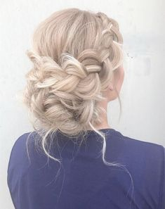 Beautiful boho braid updo bridal hairstyle for romantic bohemian brides. Get inspired by this braid updo bridal hairstylebohemian hairstyles