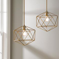 "Young House Love Equilateral Pendant This modern Young House Love pendant has a designer look geometric design. 60 watt max medium base socket. Supplied with 2 - 12"" rods and 1 - 36"" rod. 60 watt medium base socket. (16""Hx14""W)"