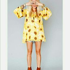 ISO Not selling. Looking for Jamie tunic . Size L,in sunflower club. Show Me Your MuMu Tops Tunics