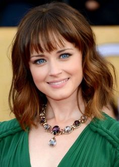 Center-parted Medium Curly Layered Hairstyle Medium-Wavy-Haircut-