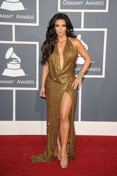 Kim Kardashian Evening Dress - Kim was a golden Goddess at the Grammys in a JLo-esque evening gown with a dramatic plunge and hip-high slit.