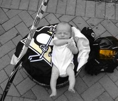 Newborn baby pictures: hockey theme