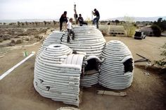 Nader Khalili has introduced an affordable, efficient and safe earth bag construction which is being referred to as a 'super adobe' style structure. The architect has focused on earth architecture by taking inspiration from ancient building techniques and Natural Building, Green Building, Building A House, Cob Building, Building Costs, Earthship, Super Adobe, Earth Dome, Emergency House