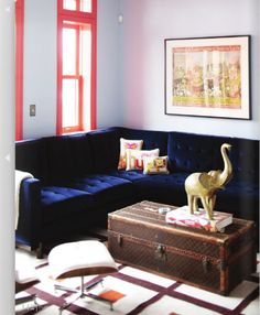 My future living room. Yves Klein blue tufted velvet sectional sofa. You could not get a more desirable group of adjectives for my dream couch. Also, I may have a well-intentioned scheme of inheriting some LV trunks.