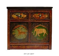This Tibetan altar table is made of solid elm wood and hand painted with elephant, deer and peony flowers graphic.   This is gorgeous altar table and you can also use it as a unique TV stand.