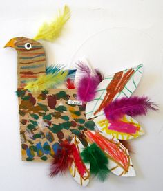 cardboard bird decorated with feathers