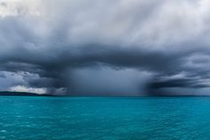 "National Geographic Your Shot on Instagram: ""Photo by John Barton @johnnyjungle  Mesmerizing light falls over the Indian Ocean as an approaching thundercloud opens to release a heavy…"""