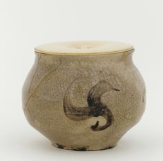 Small Korean jar, adapted to use in Japan as a tea caddy, Joseon period, first half of 17th century.