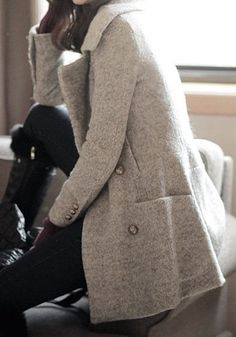 Grey peacoat, black pants and high boots. Winter collection.