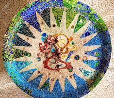 Photo about A closeup of part of a ceramic mosaic by Gaudi, taken in Park Guell in Barcelona, Spain. Image of white, gaudi, details - 3585215 Gaudi Mosaic, Antonio Gaudi, Barcelona Catalonia, Photo Images, Holy Cross, Mosaic Designs, Illustrations, Recycled Art, Royalty Free Stock Photos