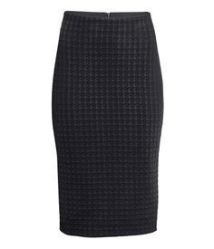 Pencil skirt in jacquard-knit fabric with a houndstooth structure. Elasticized waistband, visible back zip, and slit at back. Unlined.