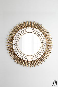 Add a burst of sun to your home with this Interlude Maya Mirror.