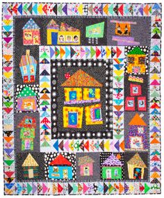 i love this quilt....it represents what quilting means to me, Fun, using great fabric and not cutting it to bits and color!!! I can make a quilt, but I am not 'A Quilter'. If I were I would make this quilt.