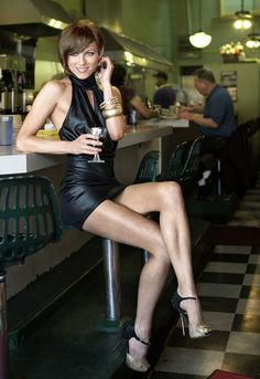 latexoid: Danielle Asher Great legs in a sexy little black leather number with sky high heels