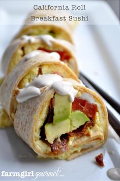 California Roll Breakfast Sushi via farmgirlgourmet.com~T~ kind of like a breakfast burrito, eggs, cheese , bacon, avocado, tomato, flour tortillas rolled together with a Spicy Sour Cream sauce. Yum