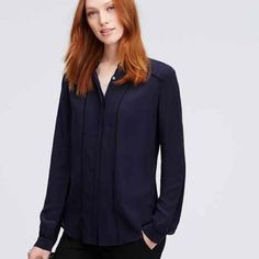 Navy Silk Piped Blouse Size L navy blouse with hidden button placket, black piped detail, and gold buttons at collar and cuffs. 100% silk, NWT. Ann Taylor Tops Blouses