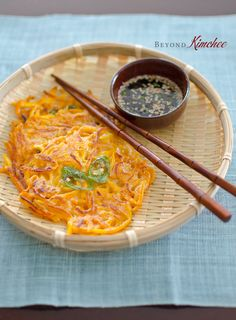 Turn ordinary pumpkin into simple and easy to make Korean style pumpkin pancakes. A healthy and delicious snack idea!