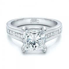 #101107 This beautiful engagement ring was custom designed for a client by Joseph Jewelry.This ring features a princess cut diamond accented with channel set...