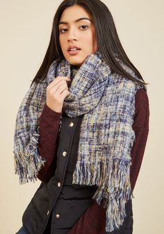 Take up residence around your fire pit for the evening and chill the comfort of this soft, plaid scarf. Knit with fuzzy navy ,sky blue, white, and chartreuse threads, this fringe-adorned wrap will not only keep you snug, but super stylish, as well!