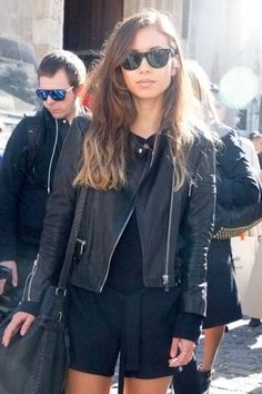 Throw a leather jacket over a chic romper for relaxed downtown style.  Paris - Street Fashion.