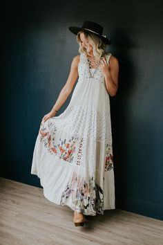 """Beautiful bohemian maxi dress featuring lace-up details at the neckline, tribal-inspired embroidery, crochet cutouts and a mixed print design. Flowing Silhouette Unfinished edges for a lived-in look Lined Skirt Model is 5'9"""" + Wearing a Small"""