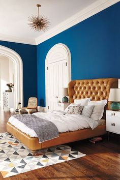 leather tufted bed in blue room