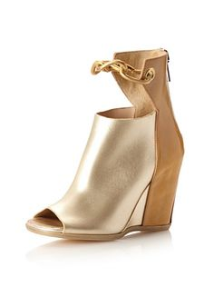 www.myhabit.com  Bold golden links create a unique ankle strap on this towering wedge style with a squared open toe and back zip entry