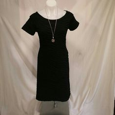 SEXY LITTLE BLACK DRESS size8 Dresss has scrunched look which is stretchy and super flattering. Newport news brand. Worn once. Bundles are always welcomed!! Pet free smoke free home!!!! Newport News Dresses Mini