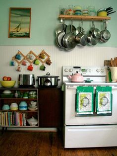 Bohemian kitchen.  Great utilization of space: hang the pots and the cups.