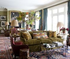 """The Ziegler Sultanabad Persian rug sets the tone in this country house,"" notes Redd. He added even more pattern with ikat and tiger-striped throw pillows, filling the room with fun colour."