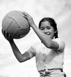 Girl playing with a ball at the Manzanar Relocation Center in 1943.  Photo by Ansel Adams for the Manzanar War Relocation Center project.