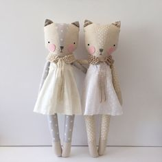 Luckyjuju dolls are handmade from mostly new and sometimes vintage fabrics, felt, lace, ribbon, yarn and polyfill stuffing. The face is hand embroidered with floss. Each doll is unique and handmade by me with love and care. This sweet cream kitty comes with a removable dress and a hand knit shawl.*** approx 19 tall including ears This listing is for the kitty on the left only. ***Children under 3 should not be left unsupervised when kitty is wearing removable accessories.