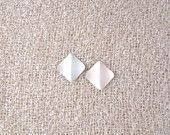 Vintage diamond shaped white stud earrings.