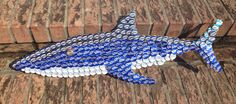 My handmade bottle cap Brew Shark! Made out of flattened Bud Light, Miller Light… My handmade bottle cap Brew Shark! Made out of flattened Bud Light, Miller Light & Mich Ultra caps collected from the restaurant I work in. Beer Cap Crafts, Beer Bottle Crafts, Bottle Cap Projects, Beer Cap Art, Beer Caps, Bottle Cap Table, Bottle Cap Art, Bud Light, Man Crafts