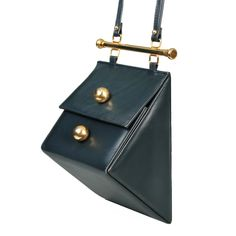 Architectural Triangle  Shoulder Bag | From a collection of rare vintage shoulder bags at https://www.1stdibs.com/fashion/handbags-purses-bags/shoulder-bags/