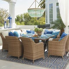 Bowing gently backward like O'Keefe's calla lilies, our handwoven Beaumont Dining Set sighs with the grace of relaxed outdoor dining. Includes four armchairs, right-facing loveseat, left-facing loveseat, corner and square table to seat eight. The all-weather resin wicker is umber-hued with textural braids along the arms and backs, accented with cloud-soft, ultra-resilient acrylic cushions. The epitome of easy outdoor dining Handwoven premium resin wicker has a warm umber hue t...