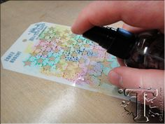 Instead of using the stencil the normal way, by applying ink or paint through the holes, you can also use dye ink pads to color the stencil itself. Spray mist with water and press onto your paper to transfer the image.